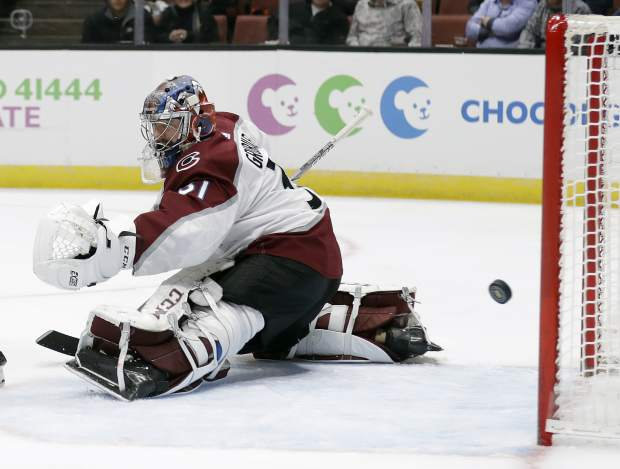 Colorado Avalanche goaltender Philipp Grubauer gives up a goal on a shot from Anaheim Ducks' Cam Fowler during the second period of an NHL hockey game Sunday, March 3, 2019, in Anaheim, Calif. (AP Photo/Marcio Jose Sanchez)