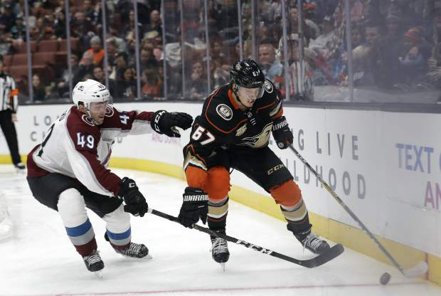 Anaheim Ducks' Rickard Rakell, right, is defended by Colorado Avalanche's Samuel Girard during the first period of an NHL hockey game Sunday, March 3, 2019, in Anaheim, Calif. (AP Photo/Marcio Jose Sanchez)