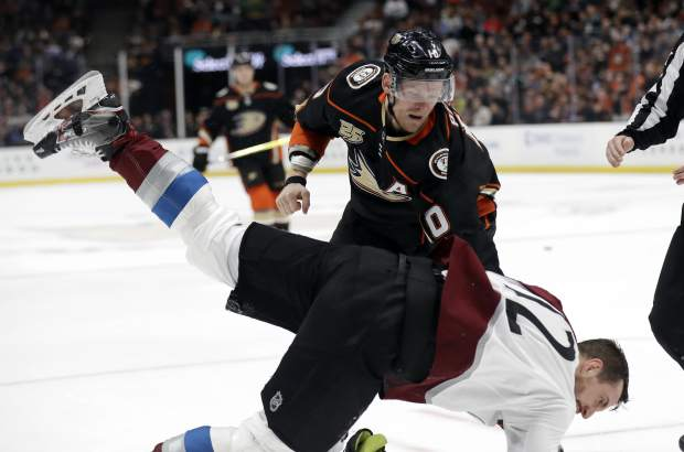 Anaheim Ducks' Corey Perry, top, fights with Colorado Avalanche's Patrik Nemeth during the second period of an NHL hockey game Sunday, March 3, 2019, in Anaheim, Calif. (AP Photo/Marcio Jose Sanchez)