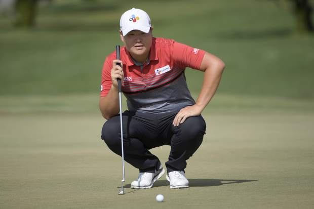 Sungjae Im, of South Korea, lines up a putt on the 15th green during the final round of the Arnold Palmer Invitational golf tournament Sunday, March 10, 2019, in Orlando, Fla. (AP Photo/Phelan M. Ebenhack)
