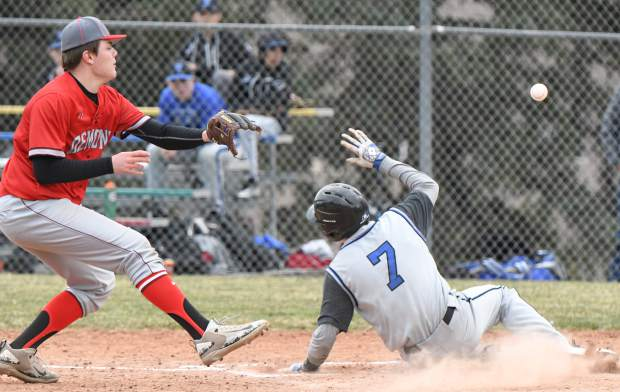 Coal Ridge Titan Ryan Kotz slides into home for a run against the Glenwood Springs Demons on Thursday afternoon.