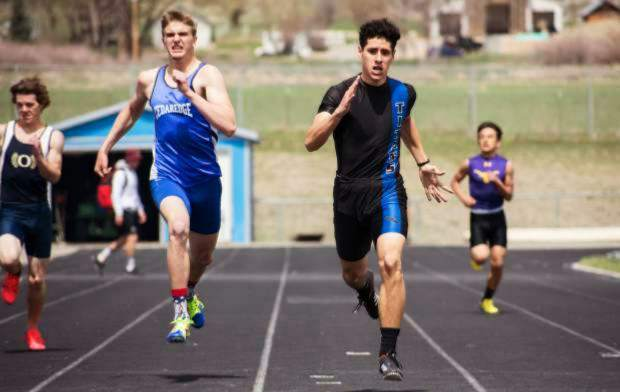 Coal Ridge sophomore Moises Contreras runs away from a Cedaredge athlete during the Titans' home meet last season. Contreras is one of the top returning boys athletes for the Titans this spring.