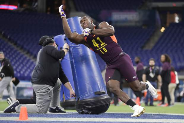 LSU linebacker Devin White runs a drill at the NFL football scouting combine in Indianapolis, Sunday, March 3, 2019. (AP Photo/Michael Conroy)
