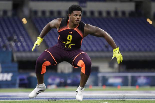 Michigan linebacker Devin Bush runs a drill at the NFL football scouting combine in Indianapolis, Sunday, March 3, 2019. (AP Photo/Michael Conroy)