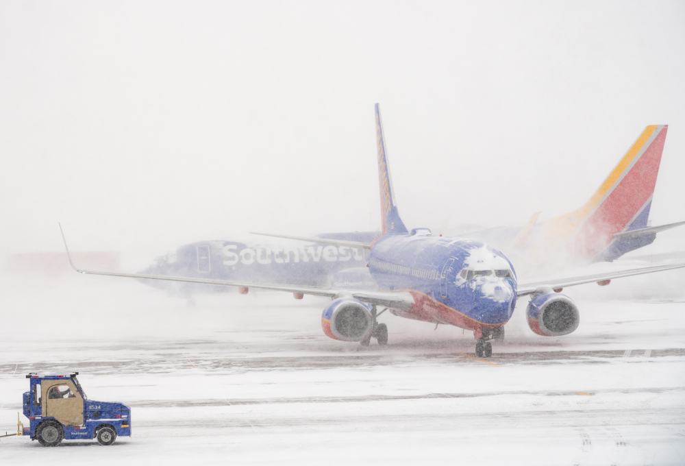All Denver International Airport runways closed, 1,300 ...