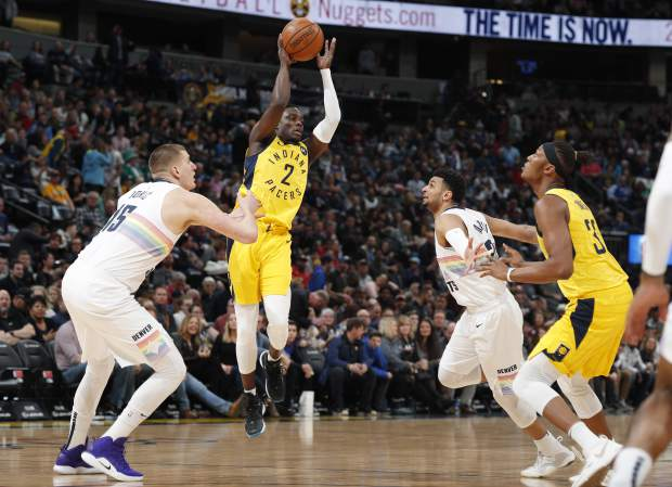 Indiana Pacers guard Darren Collison, second from left, looks to pass the ball to center Myles Turner, right, as Denver Nuggets center Nikola Jokic, left, and guard Jamal Murray defend during the first half of an NBA basketball game Saturday, March 16, 2019, in Denver. (AP Photo/David Zalubowski)