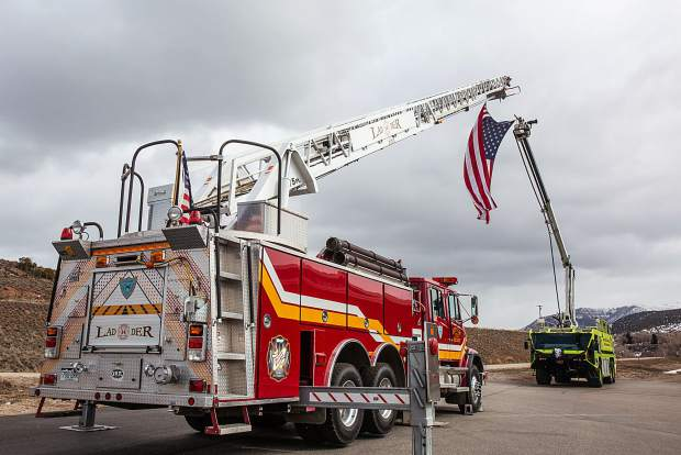 Firetrucks are placed to create an archway outside of the Eagle River Center at the Eagle County Faigrounds in honor of Eric Hill.