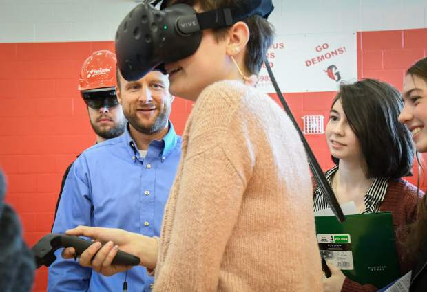 Haselden representative Matt Underwood shows students how they utilize virtual reality goggles at the GlenX Career Expo at Glenwood Springs High School on Tuesday morning.