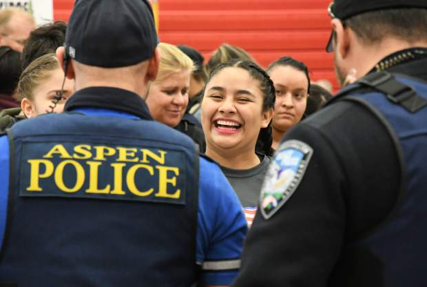 Basalt High School senior Kimberlyn Sanchez speaks with local police officers at the GlenX Career Expo at Glenwood Springs High School on Tuesday morning.