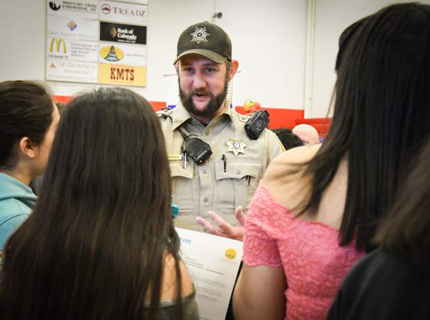 Deputy Bowen with the Garfield County Sheriff's Office speaks to students at the GlenX Career Expo at Glenwood Springs High School on Tuesday morning.