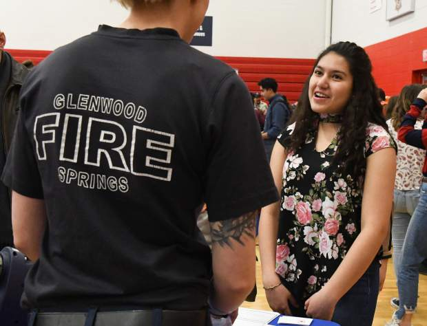 Glenwood Springs High School sophomore Ashley Cano speaks with a representative of the Glenwood Springs Fire Department at the GlenX Career Expo on Tuesday morning.