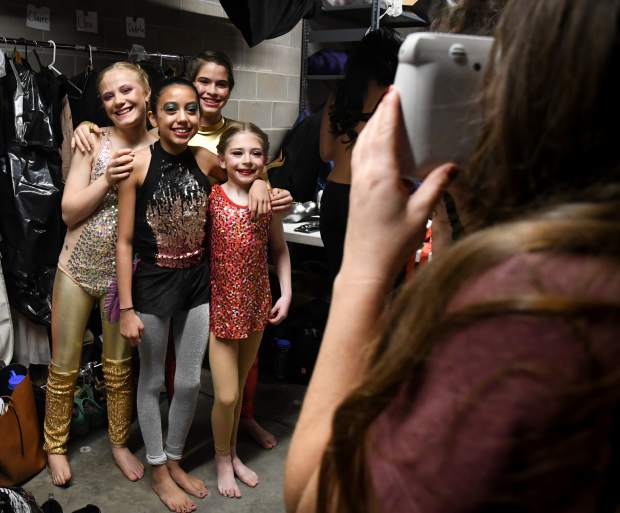 Young dancers get their photo taken together backstage before the start of the sold out show on Friday evening.