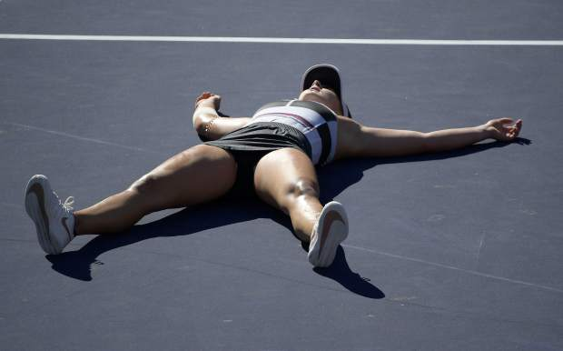 Bianca Andreescu, of Canada, celebrates after defeating Angelique Kerber, of Germany, during the women's final at the BNP Paribas Open tennis tournament Sunday, March 17, 2019, in Indian Wells, Calif. Andreescu won 6-4, 3-6, 6-4.(AP Photo/Mark J. Terrill)