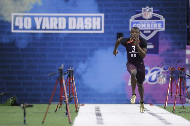 Georgia defensive back Deandre Baker runs the 40-yard dash during the NFL football scouting combine, Monday, March 4, 2019, in Indianapolis. (AP Photo/Darron Cummings)