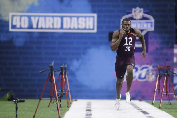Auburn defensive back Jamel Dean runs the 40-yard dash during the NFL football scouting combine, Monday, March 4, 2019, in Indianapolis. (AP Photo/Darron Cummings)