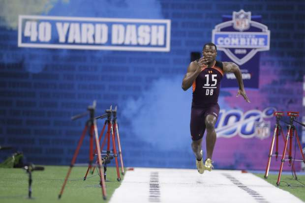 Northwestern defensive back Montre Hartage runs the 40-yard dash during the NFL football scouting combine, Monday, March 4, 2019, in Indianapolis. (AP Photo/Darron Cummings)
