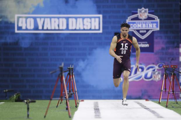 Stanford defensive back Alijah Holder runs the 40-yard dash during the NFL football scouting combine, Monday, March 4, 2019, in Indianapolis. (AP Photo/Darron Cummings)