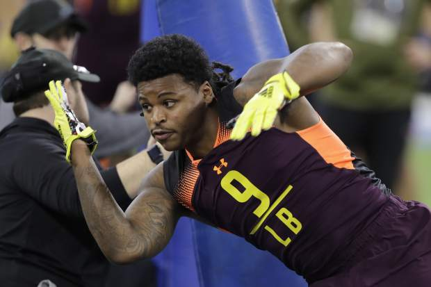Michigan linebacker Devin Bush runs a drill during the NFL football scouting combine, Sunday, March 3, 2019, in Indianapolis. (AP Photo/Darron Cummings)