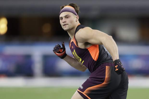 Minnesota linebacker Blake Cashman runs a drill during the NFL football scouting combine, Sunday, March 3, 2019, in Indianapolis. (AP Photo/Darron Cummings)