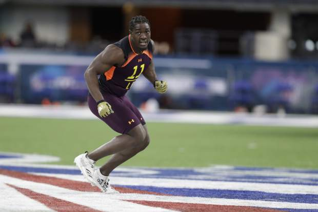 Notre Dame linebacker Te'von Coney runs a drill during the NFL football scouting combine, Sunday, March 3, 2019, in Indianapolis. (AP Photo/Darron Cummings)