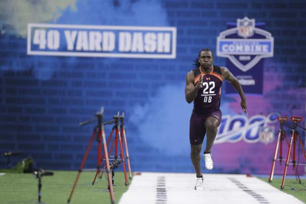 Michigan defensive back David Long runs the 40-yard dash during the NFL football scouting combine, Monday, March 4, 2019, in Indianapolis. (AP Photo/Darron Cummings)