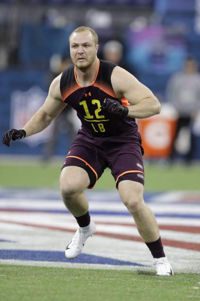 Wisconsin linebacker Ryan Connelly runs a drill during the NFL football scouting combine, Sunday, March 3, 2019, in Indianapolis. (AP Photo/Darron Cummings)