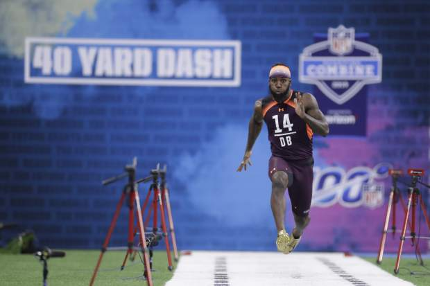 Clemson defensive back Mark Fields runs the 40-yard dash during the NFL football scouting combine, Monday, March 4, 2019, in Indianapolis. (AP Photo/Darron Cummings)
