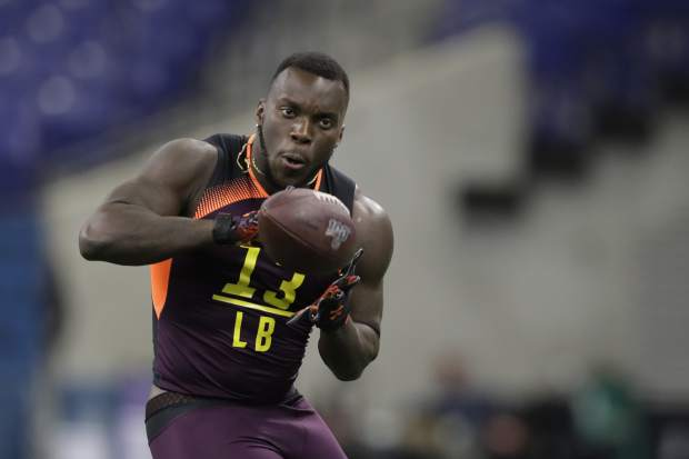 Auburn linebacker Deshaun Davis runs a drill during the NFL football scouting combine, Sunday, March 3, 2019, in Indianapolis. (AP Photo/Darron Cummings)