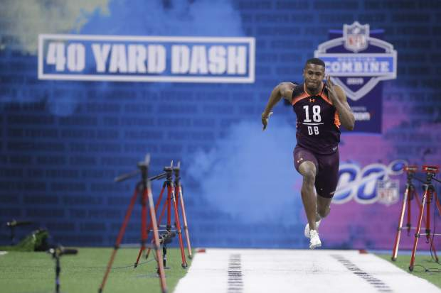 Houston defensive back Isaiah Johnson runs the 40-yard dash during the NFL football scouting combine, Monday, March 4, 2019, in Indianapolis. (AP Photo/Darron Cummings)