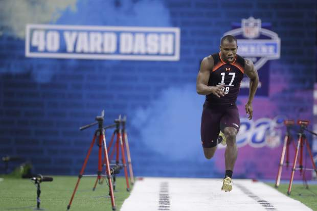 Miami defensive back Michael Jackson Sr. runs the 40-yard dash during the NFL football scouting combine, Monday, March 4, 2019, in Indianapolis. (AP Photo/Darron Cummings)