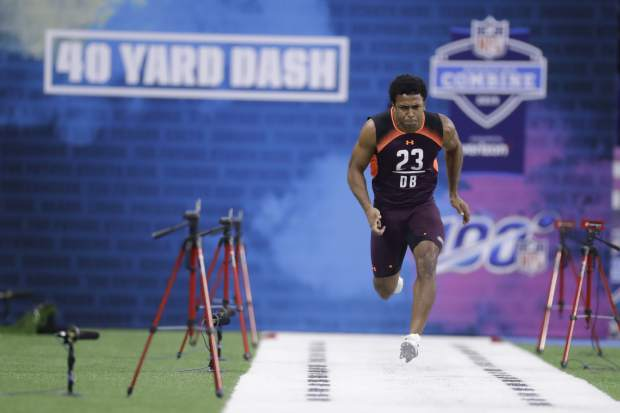 Notre Dame defensive back Julian Love runs the 40-yard dash during the NFL football scouting combine, Monday, March 4, 2019, in Indianapolis. (AP Photo/Darron Cummings)