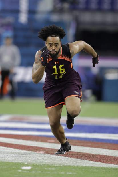 Houston linebacker Emeke Egbule runs a drill during the NFL football scouting combine, Sunday, March 3, 2019, in Indianapolis. (AP Photo/Darron Cummings)