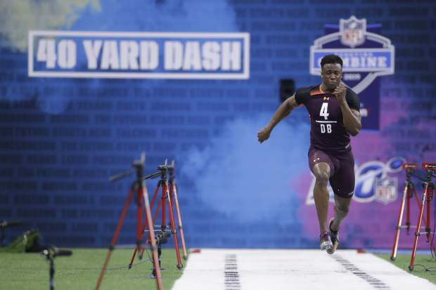 Washburn defensive back Corey Ballentine runs the 40-yard dash during the NFL football scouting combine, Monday, March 4, 2019, in Indianapolis. (AP Photo/Darron Cummings)