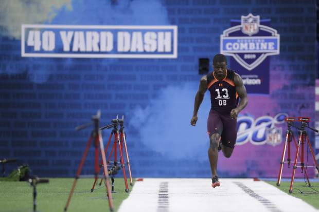 South Carolina defensive back Rashad Fenton runs the 40-yard dash during the NFL football scouting combine, Monday, March 4, 2019, in Indianapolis. (AP Photo/Darron Cummings)