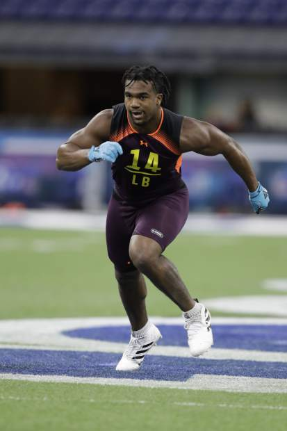 Texas A&M linebacker Tyrel Dodson runs a drill during the NFL football scouting combine, Sunday, March 3, 2019, in Indianapolis. (AP Photo/Darron Cummings)