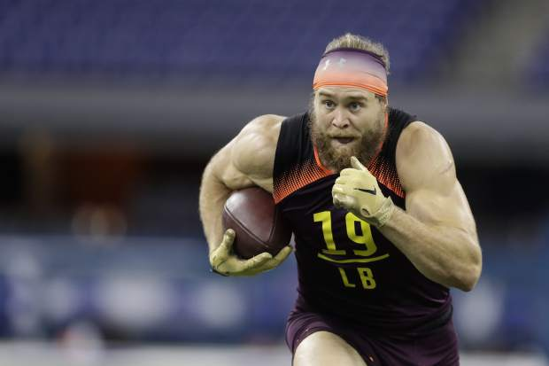 USC linebacker Porter Gustin runs a drill during the NFL football scouting combine, Sunday, March 3, 2019, in Indianapolis. (AP Photo/Darron Cummings)