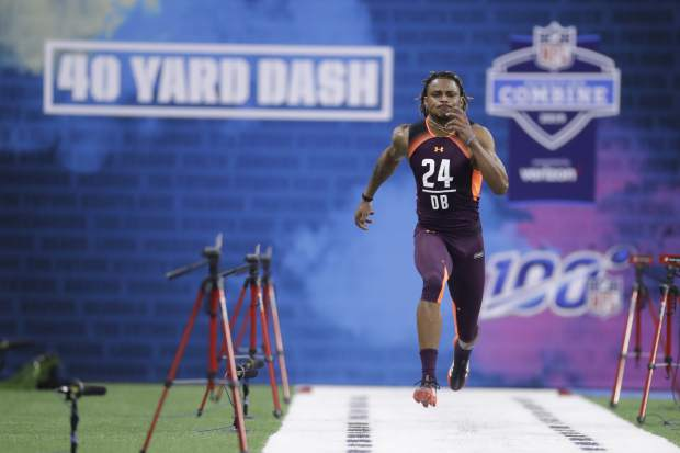 Washington defensive back Jordan Miller runs the 40-yard dash during the NFL football scouting combine, Monday, March 4, 2019, in Indianapolis. (AP Photo/Darron Cummings)