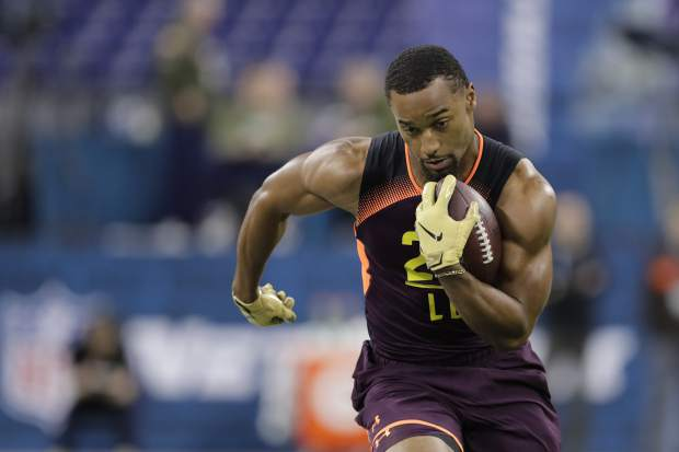 Oregon linebacker Justin Hollins runs a drill during the NFL football scouting combine, Sunday, March 3, 2019, in Indianapolis. (AP Photo/Darron Cummings)