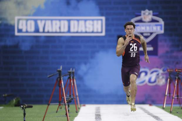 Washington defensive back Byron Murphy runs the 40-yard dash during the NFL football scouting combine, Monday, March 4, 2019, in Indianapolis. (AP Photo/Darron Cummings)