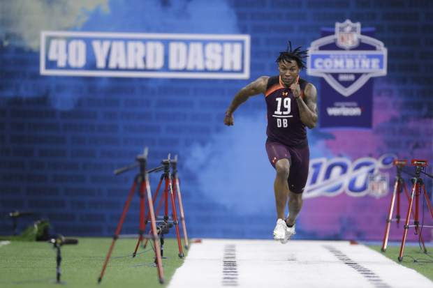 Kentucky defensive back Lonnie Johnson Jr. runs the 40-yard dash during the NFL football scouting combine, Monday, March 4, 2019, in Indianapolis. (AP Photo/Darron Cummings)