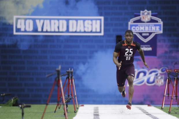 Clemson defensive back Trayvon Mullen runs the 40-yard dash during the NFL football scouting combine, Monday, March 4, 2019, in Indianapolis. (AP Photo/Darron Cummings)
