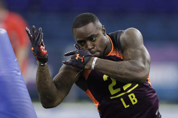 Texas linebacker Gary Johnson runs a drill during the NFL football scouting combine, Sunday, March 3, 2019, in Indianapolis. (AP Photo/Darron Cummings)