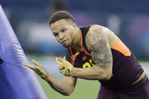Kentucky linebacker Jordan Jones runs a drill during the NFL football scouting combine, Sunday, March 3, 2019, in Indianapolis. (AP Photo/Darron Cummings)