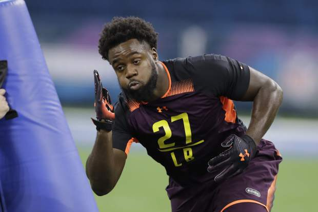 Clemson linebacker Kendall Joseph runs a drill during the NFL football scouting combine, Sunday, March 3, 2019, in Indianapolis. (AP Photo/Darron Cummings)
