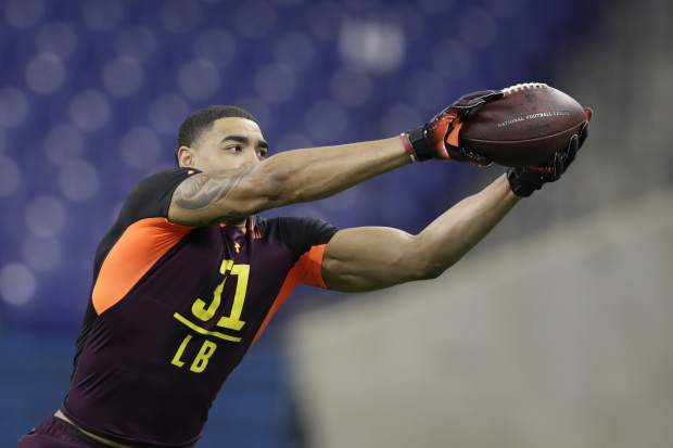 Alabama linebacker Christian Miller runs a drill during the NFL football scouting combine, Sunday, March 3, 2019, in Indianapolis. (AP Photo/Darron Cummings)