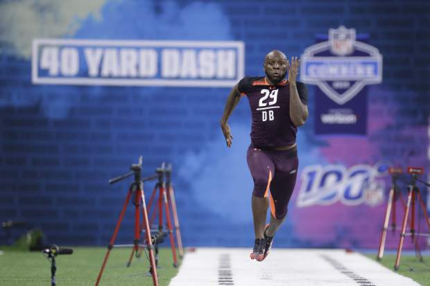 Arkansas defensive back Ryan Pulley runs the 40-yard dash during the NFL football scouting combine, Monday, March 4, 2019, in Indianapolis. (AP Photo/Darron Cummings)