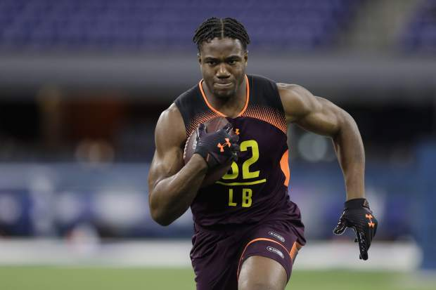 Stanford linebacker Bobby Okereke runs a drill during the NFL football scouting combine, Sunday, March 3, 2019, in Indianapolis. (AP Photo/Darron Cummings)