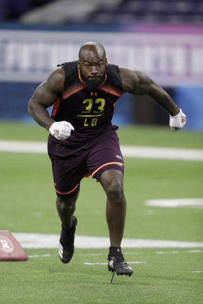 North Carolina State linebacker Germaine Pratt runs a drill during the NFL football scouting combine, Sunday, March 3, 2019, in Indianapolis. (AP Photo/Darron Cummings)