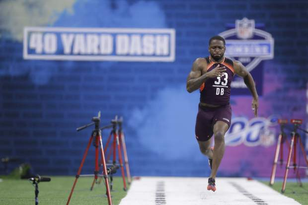 Mississippi defensive back Ken Webster runs the 40-yard dash during the NFL football scouting combine, Monday, March 4, 2019, in Indianapolis. (AP Photo/Darron Cummings)