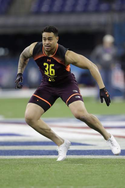 BYU linebacker Sione Takitaki runs a drill during the NFL football scouting combine, Sunday, March 3, 2019, in Indianapolis. (AP Photo/Darron Cummings)